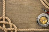 Ship ropes and compass at old wood — Stock Photo