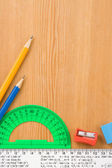 School accessories and supplies on wood — Stock Photo