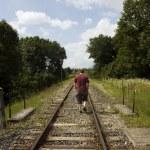 Man following tracks — Stock Photo