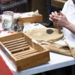 Stock Photo: Rolling cigars