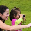 Mother and Child With Binoculars — Stock Photo #10779372