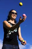 Woman Juggling Balls — Stock Photo