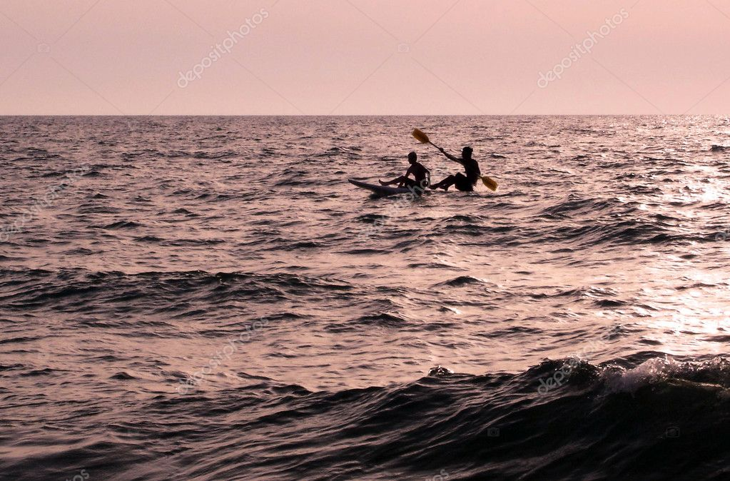 Two raws a canoe over the ocean at sunset — Stock Photo #10799966