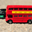 A bright red traditional London Bus and Black Taxi isolated over tar-seal. — Photo #10847435