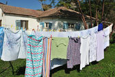 Drying clothes outside — Stock Photo