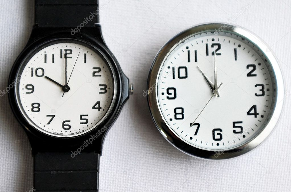 Clock and watche that show the time during  Daylight saving time (DST). — Stock Photo #10847985