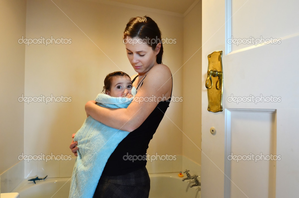 A young mother bathing her baby. — Stock Photo #10853443