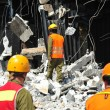 Stock Photo: Search and Rescue Through Building Rubble after Disaster