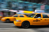 Blurry taxi new york — Stock Photo