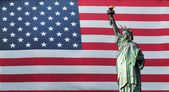 Statue of Liberty with American Flag — Stock Photo