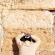 Man Praying at Western Wall - Stock Photo