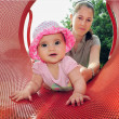 Baby Girl Plays with Mum in Playground — Stock Photo
