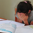 Young Girl Struggles with her homework — Stock Photo