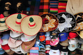 Mexican sombreros and cowboy hats — Stock Photo