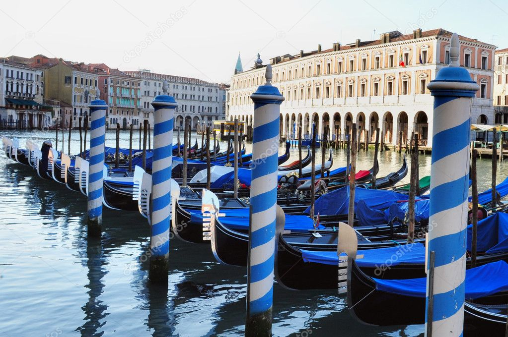 Gondolas mooring against colorful buildings on the Grand Canal in Venice, Italy. — Stock Photo #11206065