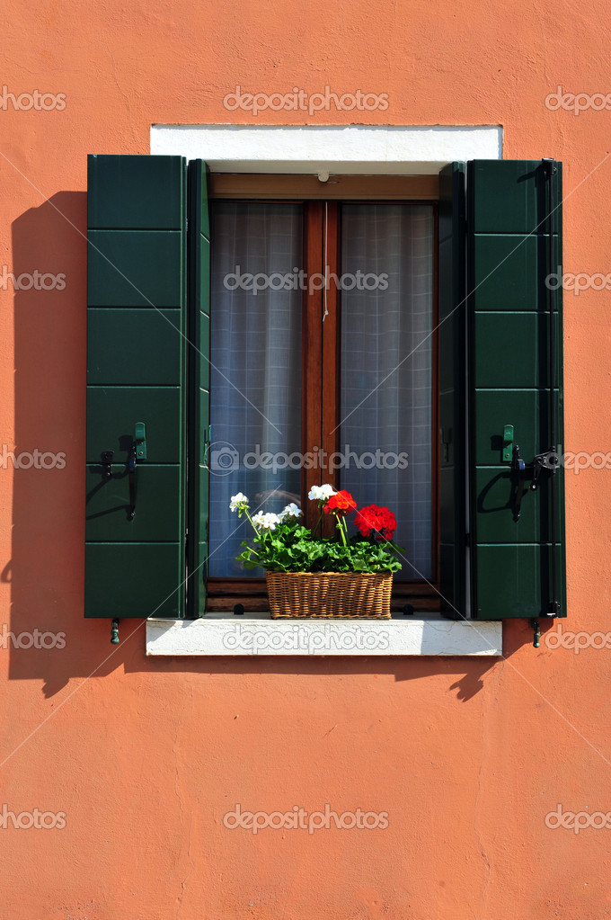 Colourfully painted window on Burano island in the Venetian Lagoon, northern Italy. — Stock Photo #11206114