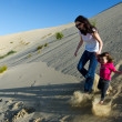 Mother and child in the desert - Stock Photo
