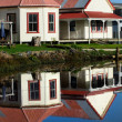 Reflection of old ruin houses - Stock Photo