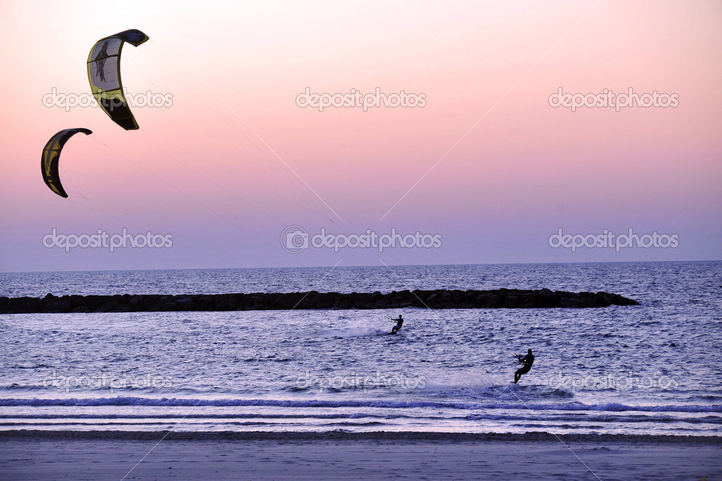 Kiteboarding along Tel-Aviv beach on the coastline of the Mediterranean sea. Israel. — Stock Photo #12098349