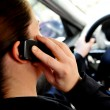 Mobile phones and driving - Stock Photo