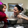 Stock Photo: Mother and daughter cooking together
