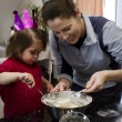 Mother and daughter cooking together — Stock Photo #12405908