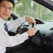 Chinese businessman inside car — Stock Photo #10741215