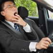 Yawning while driving — Stockfoto