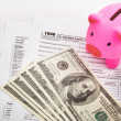 Piggy bank and tax forms — Stock Photo