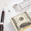 Dollar and tax forms — Stock Photo