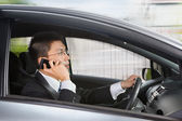 Talking on phone while driving — Stock Photo