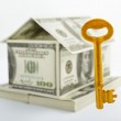 House shaped dollars and golden key — Stock Photo #10751231