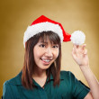 Girl with santa hat — Stock Photo #10752610