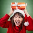 Christmas girl holding gift — Stock Photo