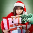 Christmas girl carrying presents — Stock Photo
