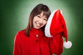 Kerstmis meisje poseren met kerstmuts — Stockfoto