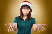Girl with santa hat have no idea — Stock Photo