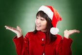 Christmas girl with choice — Stockfoto
