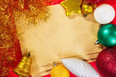 Blank paper and Christmas ornaments — Stock Photo