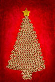 Golden chain Christmas tree on red — Stock Photo
