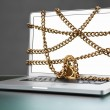Open laptop with chain and lock — Stock Photo
