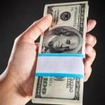 Hand holding money — Stock Photo