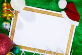 Paper and Christmas Ornaments — Stock Photo