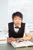 Chinese college male awake in classroom — Stock Photo