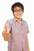 Chinese young adult with thumb up — Stock Photo
