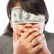 Businesswoman being blinded with money — Stock Photo
