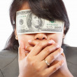 Businesswoman being blinded with money - Stock Photo