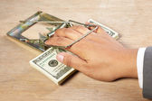Trapped when catching money — Stock Photo