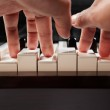 Playing piano from low angle — Stock Photo #10781138