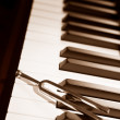 Stock Photo: Piano and tuning forl